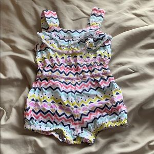 Printed onesie with gold accents